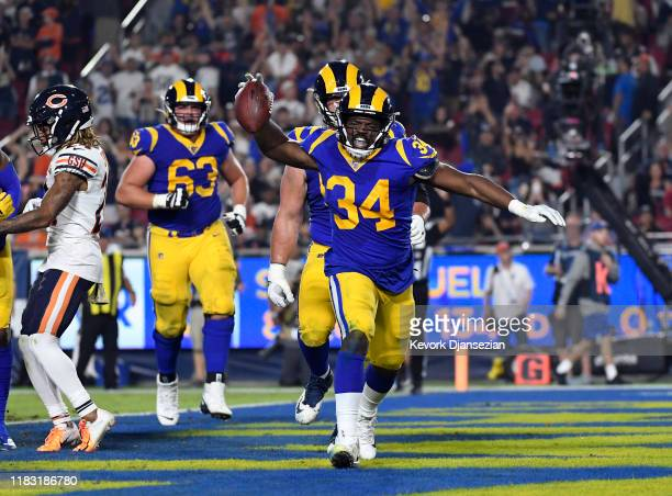 Malcolm Brown of the Los Angeles Rams celebrates after running into the end zone to score a touchdown during the second half against Chicago Bears at...