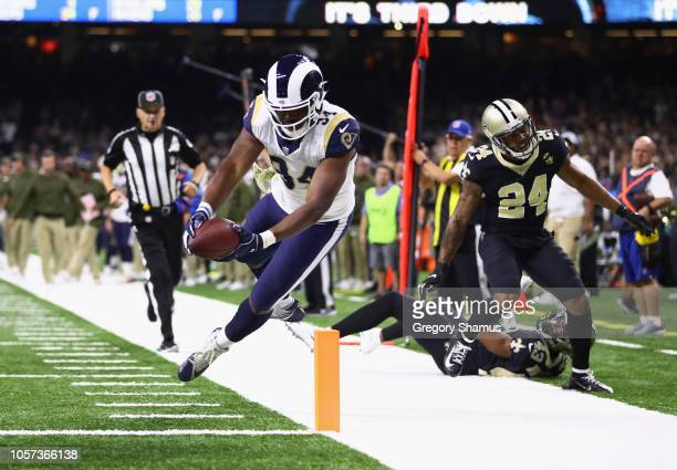 Malcolm Brown of the Los Angeles Rams leaps to score a touchdown during the third quarter of the game against the New Orleans Saints at MercedesBenz...