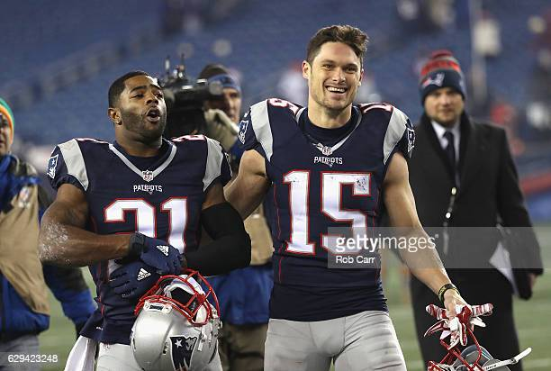 Malcolm Butler and Chris Hogan of the New England Patriots react as they walk off the field after defeating the Baltimore Ravens 3023 at Gillette...