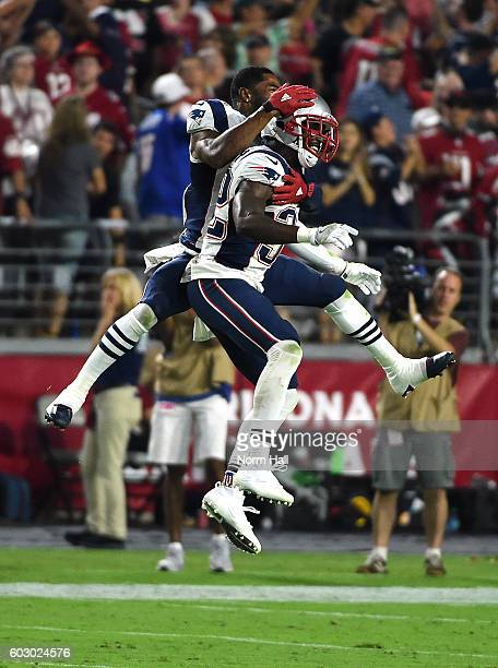 Malcolm Butler and Devin McCourty of the New England Patriots celebrate a 2321 win against the Arizona Cardinals at University of Phoenix Stadium on...