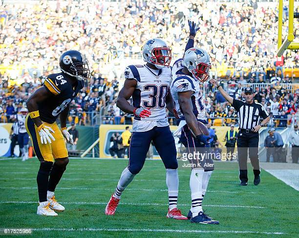 Malcolm Butler of the New England Patriots celebrates after intercepting a pass intended for Antonio Brown of the Pittsburgh Steelers in the first...