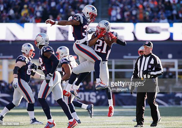 Malcolm Butler of the New England Patriots celebrates with Brandon King after intercepting Jared Goff of the Los Angeles Rams during the first half...
