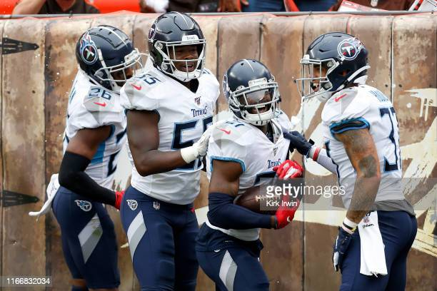 Malcolm Butler of the Tennessee Titans is congratulated by his teammates after returning an interception for a touchdown during the fourth quarter of...