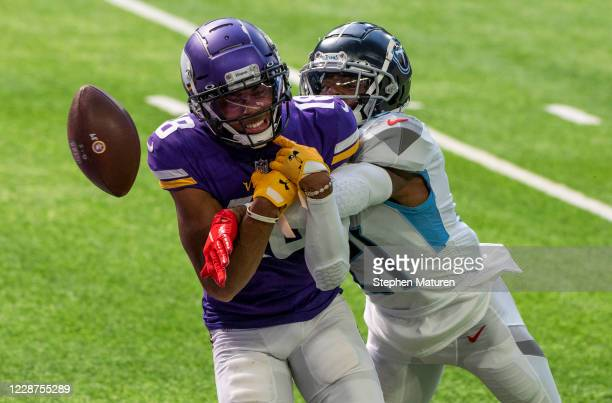 Malcolm Butler of the Tennessee Titans knocks the ball away on a deep pass to Justin Jefferson of the Minnesota Vikings in the second quarter at U.S....
