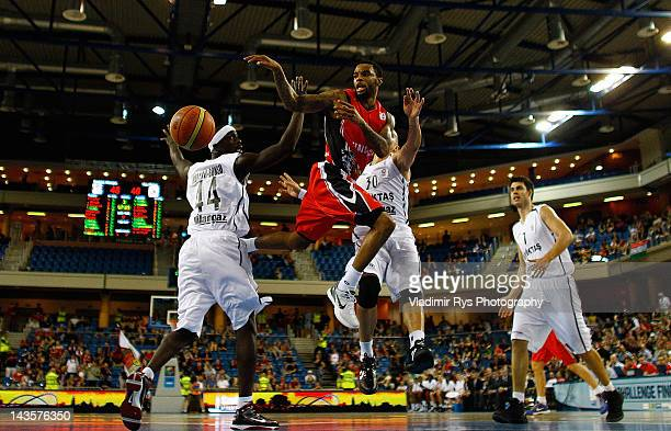 Malcolm Delaney of Chalon attacks as Pops Mensah-Bonsu and Carlos Arroyo of Besiktas defend during the FIBA Europe EuroChallenge Final Four final...