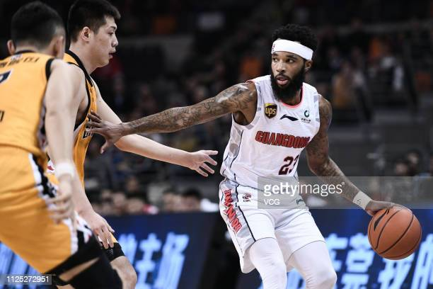 Malcolm Delaney of Guangdong Hongyuan Southern Tigers drives the ball during the 2018/2019 Chinese Basketball Association League 36th round match...