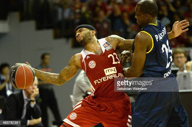 Malcolm Delaney of Munich competes with Ricky Paulding of Oldenburg during game one of the 2014 Beko BBL Playoffs SemiFinal between FC Bayern...