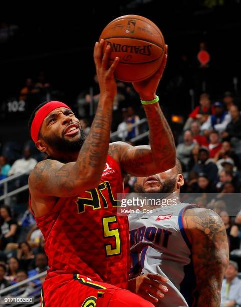 Malcolm Delaney of the Atlanta Hawks draws a foul from Jameer Nelson of the Detroit Pistons at Philips Arena on February 11 2018 in Atlanta Georgia...