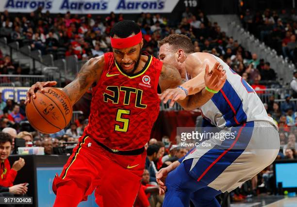 Malcolm Delaney of the Atlanta Hawks drives against Blake Griffin of the Detroit Pistons at Philips Arena on February 11 2018 in Atlanta Georgia NOTE...