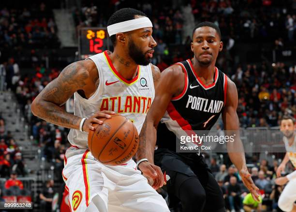 Malcolm Delaney of the Atlanta Hawks drives against Maurice Harkless of the Portland Trail Blazers at Philips Arena on December 30 2017 in Atlanta...