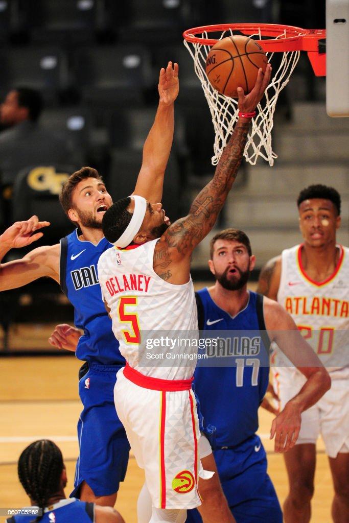 Malcolm Delaney #5 of the Atlanta Hawks goes to the basket against the Dallas Mavericks on October 12, 2017 at McCamish Pavilion in Atlanta, Georgia.