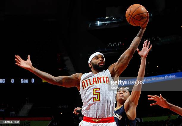 Malcolm Delaney of the Atlanta Hawks grabs a rebound against Tim Frazier of the New Orleans Pelicans at Philips Arena on October 18 2016 in Atlanta...