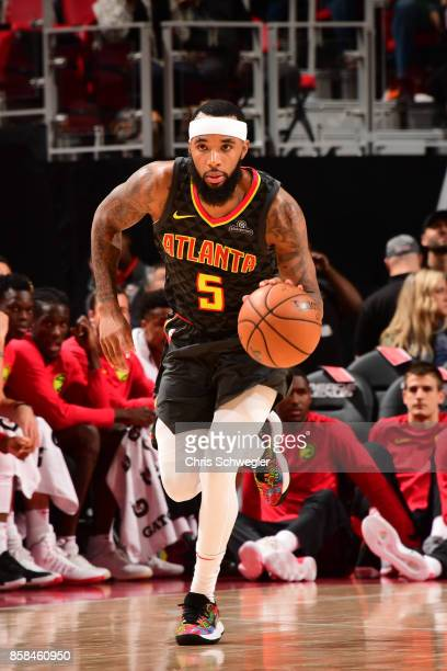 Malcolm Delaney of the Atlanta Hawks handles the ball against the Detroit Pistons on October 6 2017 at Little Caesars Arena in Detroit Michigan NOTE...