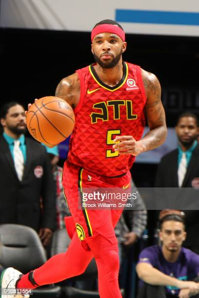 Malcolm Delaney of the Atlanta Hawks handles the ball against the Charlotte Hornets on January 26 2018 at Spectrum Center in Charlotte North Carolina...