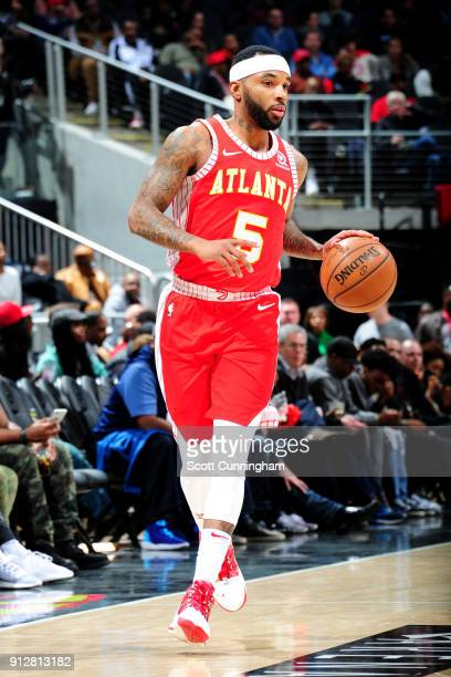 Malcolm Delaney of the Atlanta Hawks handles the ball during the game against the Charlotte Hornets on January 31 2018 at Philips Arena in Atlanta...