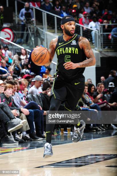 Malcolm Delaney of the Atlanta Hawks handles the ball during the game against the Cleveland Cavaliers on February 9 2018 at Philips Arena in Atlanta...