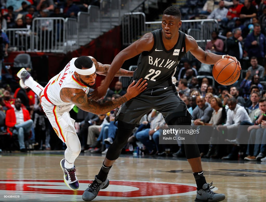 Malcolm Delaney #5 of the Atlanta Hawks tries to defend against Caris LeVert #22 of the Brooklyn Nets at Philips Arena on January 12, 2018 in Atlanta, Georgia.