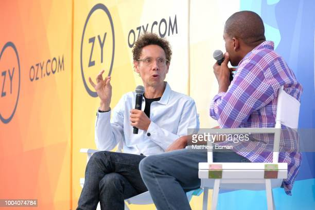 Malcolm Gladwell and Carlos Watson speak onstage during OZY Fest 2018 at Rumsey Playfield Central Park on July 22 2018 in New York City