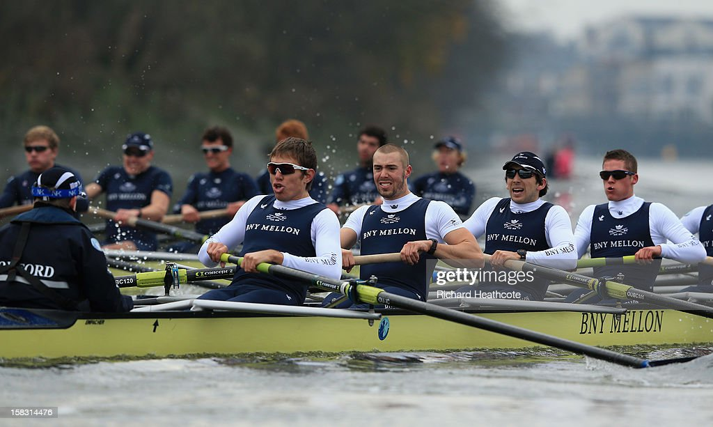 Malcolm Howard, Alex Davidson, Samuel O'Connor and Tom Watson of Oxford's 'Spitfire' crew push hard to catch 'Hurricane' during the trial 8's for The BNY Melon University Boat Race on The River Thames on December 13, 2012 in London, England.