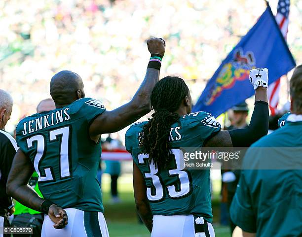 Malcolm Jenkins and Ron Brooks of the Philadelphia Eagles raise their fists in protest during the national anthem the start of a game against the...