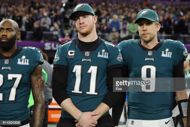 Malcolm Jenkins Carson Wentz and Nick Foles of the Philadelphia Eagles stand for the national anthem prior to Super Bowl LII against the New England...