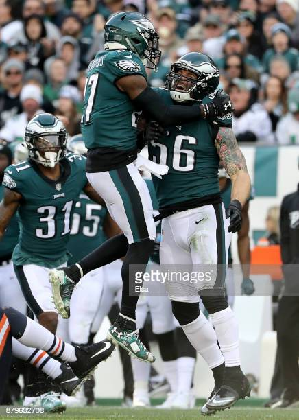 Malcolm Jenkins congratulates teammate Chris Long of the Philadelphia Eagles after a stop in the first quarter against the Chicago Bears on November...
