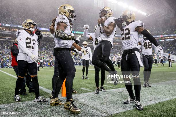 Malcolm Jenkins of the New Orleans Saints celebrates with Demario Davis following a defensive stop against the Seattle Seahawks at Lumen Field on...