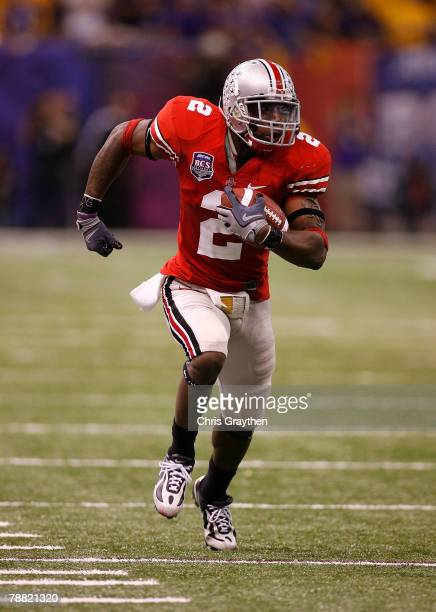 Malcolm Jenkins of the Ohio State Buckeyes runs back an interception against the Louisiana State University Tigers during the AllState BCS National...