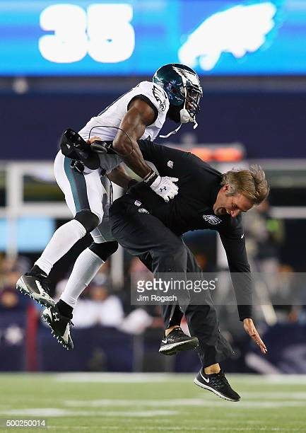 Malcolm Jenkins of the Philadelphia Eagles celebrates with defensive backs coach Cory Undlin after an incomplete New England Patriots pass leading to...