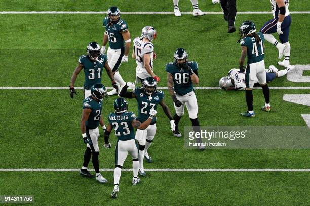 Malcolm Jenkins of the Philadelphia Eagles celebrates with Rodney McLeod after tackling Brandin Cooks of the New England Patriots during the second...