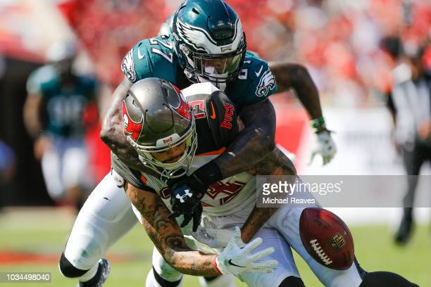 Malcolm Jenkins of the Philadelphia Eagles forces Mike Evans of the Tampa Bay Buccaneers to fumble during the second half at Raymond James Stadium on...