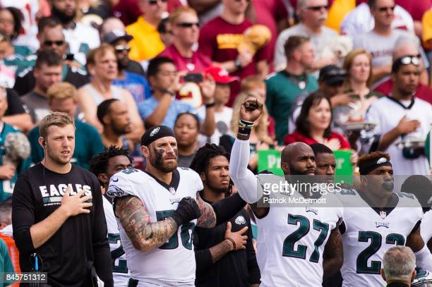 Malcolm Jenkins of the Philadelphia Eagles raises his fist as he stands during a rendition of the national anthem before an NFL football game against...