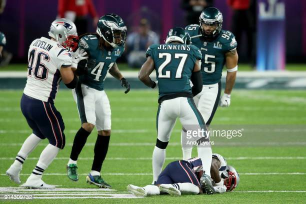 Malcolm Jenkins of the Philadelphia Eagles stands over Brandin Cooks of the New England Patriots after a tackle during the second quarter in Super...