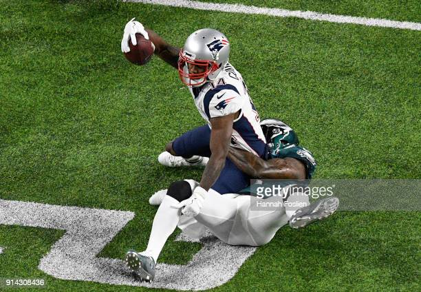 Malcolm Jenkins of the Philadelphia Eagles tackles Brandin Cooks of the New England Patriots during the first quarter in Super Bowl LII at US Bank...