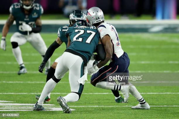 Malcolm Jenkins of the Philadelphia Eagles tackles Brandin Cooks of the New England Patriots during the second quarter in Super Bowl LII at US Bank...