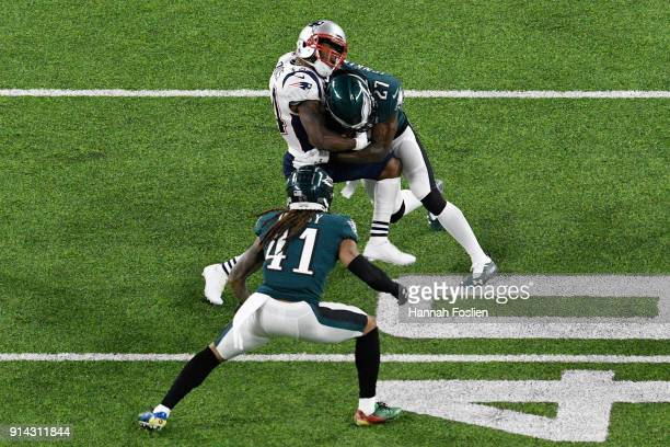 Malcolm Jenkins of the Philadelphia Eagles tackles Brandin Cooks of the New England Patriots during the second quarter in Super Bowl LII at U.S. Bank...