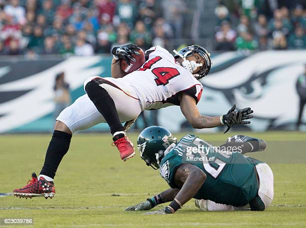 Malcolm Jenkins of the Philadelphia Eagles tackles Eric Weems of the Atlanta Falcons in the fourth quarter at Lincoln Financial Field on November 13...