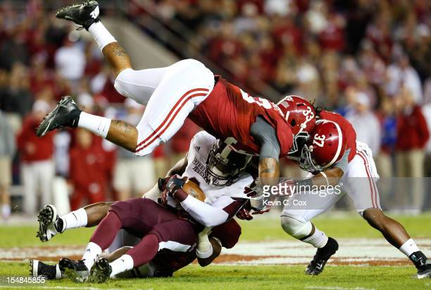Malcolm Johnson of the Mississippi State Bulldogs is tackled by Nick Perry Trey DePriest and Robert Lester of the Alabama Crimson Tide at BryantDenny...