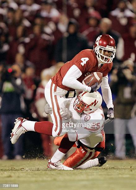 Malcolm Kelly of the Oklahoma Sooners carries the ball against Andre Jones of the Nebraska Cornhuskers during the 2006 Dr Pepper Big 12 Championship...
