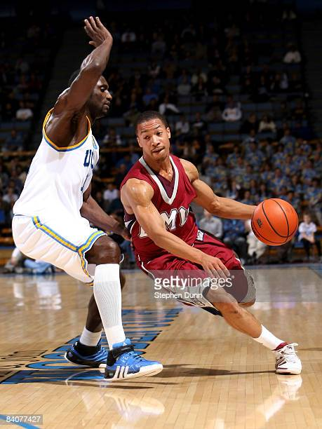 Malcolm Lee of the Loyola Marymount Lions drives around Alfred Aboya of the UCLA Bruins at Pauley Pavilion December 17 2008 in Westwood California...