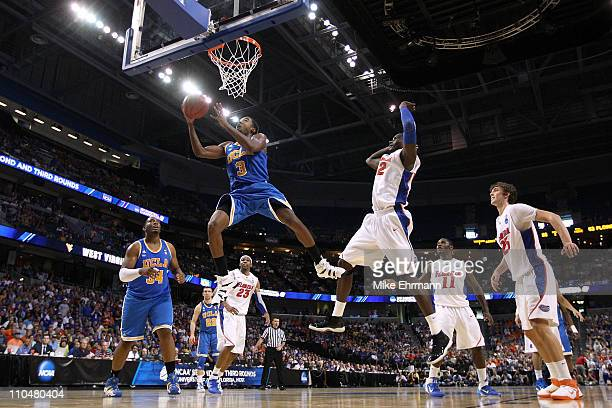 Malcolm Lee of the UCLA Bruins drives for a shot attempt against the Florida Gators during the third round of the 2011 NCAA men's basketball...
