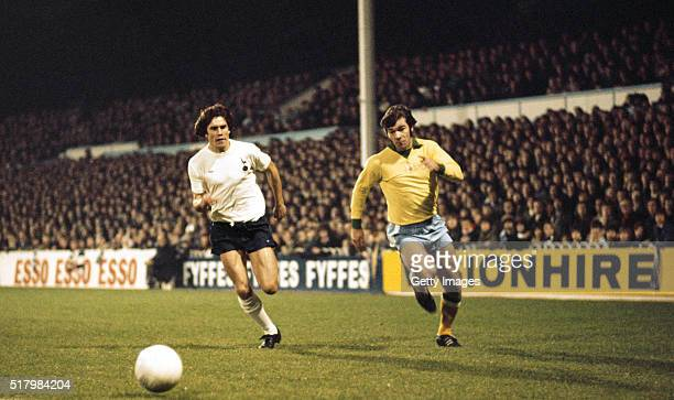 Malcolm MacDonald challenges Keith Osgood of Spurs during the 1976 League Cup Semi Final 1st Leg match between Tottenham Hotspur and Newcastle United...