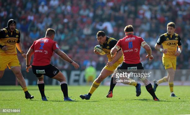 Malcolm Marx and Jaco Kriel of Lions in action with Ben May of Hurricanes during the Super Rugby Semi Final match between Emirates Lions and...