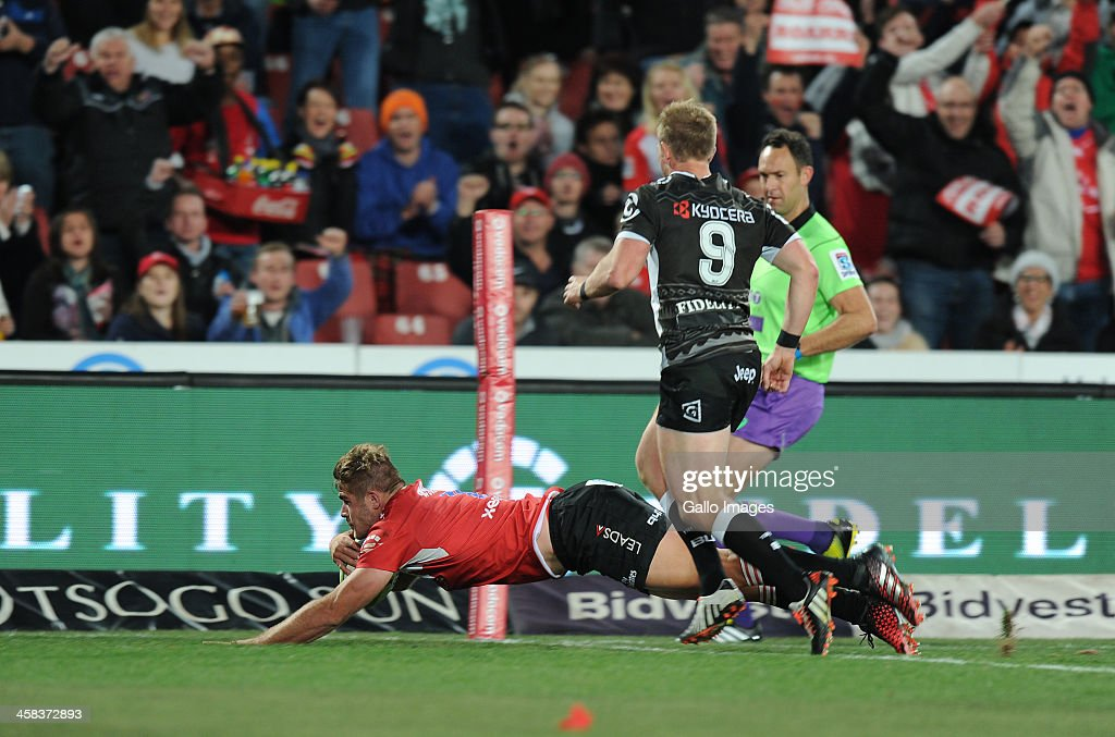 Malcolm Marx of Lions scoring a try with Micheal Claassens of Sharks looking on during the Super Rugby match between Emirates Lions and Cell C Sharks at Emirates Airline Park on July 02, 2016 in Johannesburg, South Africa.