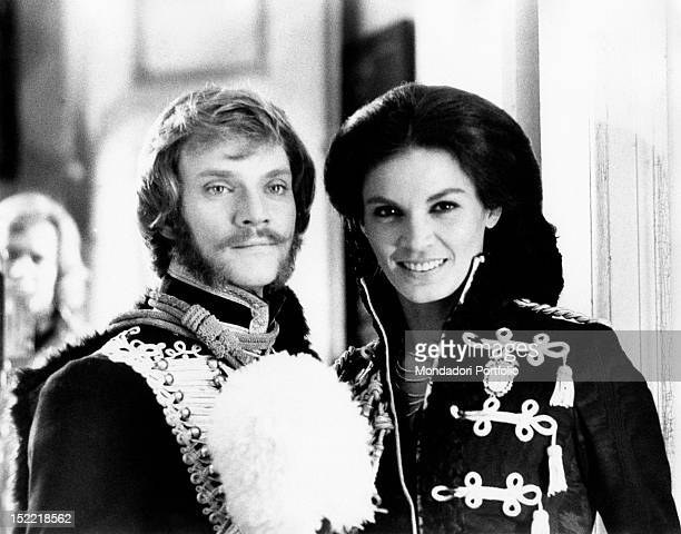 Malcolm McDowelll together with Florinda Bolkan smiling on the set of the film 'Royal Flash' Stuttgart Germany 1975