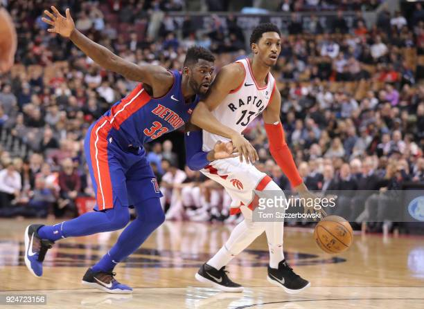 Malcolm Miller of the Toronto Raptors dribbles as he is guarded by James Ennis of the Detroit Pistons at Air Canada Centre on February 26 2018 in...