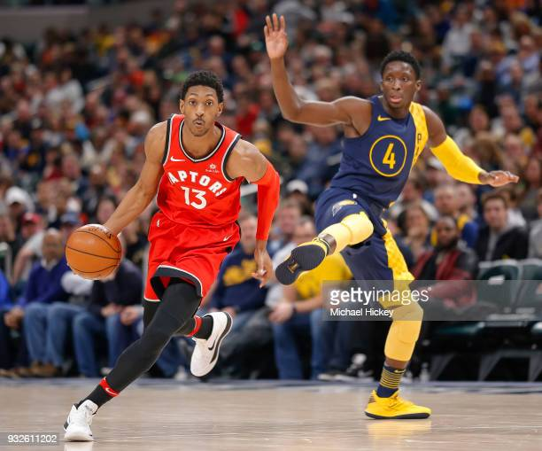 Malcolm Miller of the Toronto Raptors dribbles the ball around Victor Oladipo of the Indiana Pacers at Bankers Life Fieldhouse on March 15 2018 in...