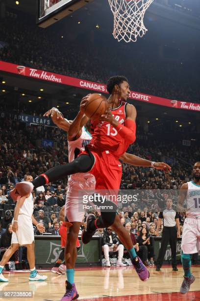 Malcolm Miller of the Toronto Raptors passes the ball against the Charlotte Hornets on March 4 2018 at the Air Canada Centre in Toronto Ontario...
