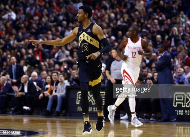 Malcolm Miller of the Toronto Raptors points to a teammate during the first half of an NBA game against the Houston Rockets at Air Canada Centre on...