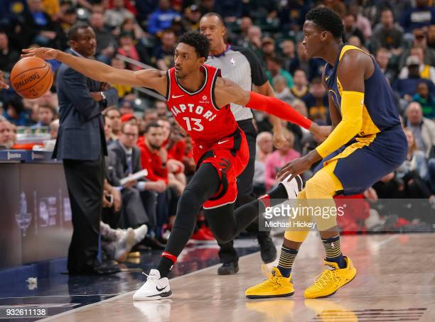 Malcolm Miller of the Toronto Raptors reaches for the ball as Victor Oladipo of the Indiana Pacers defends at Bankers Life Fieldhouse on March 15...
